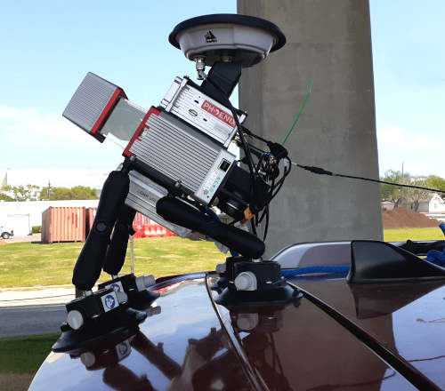 Phoenix LiDAR MiniRanger secured on the hood of a truck ready to begin scanning